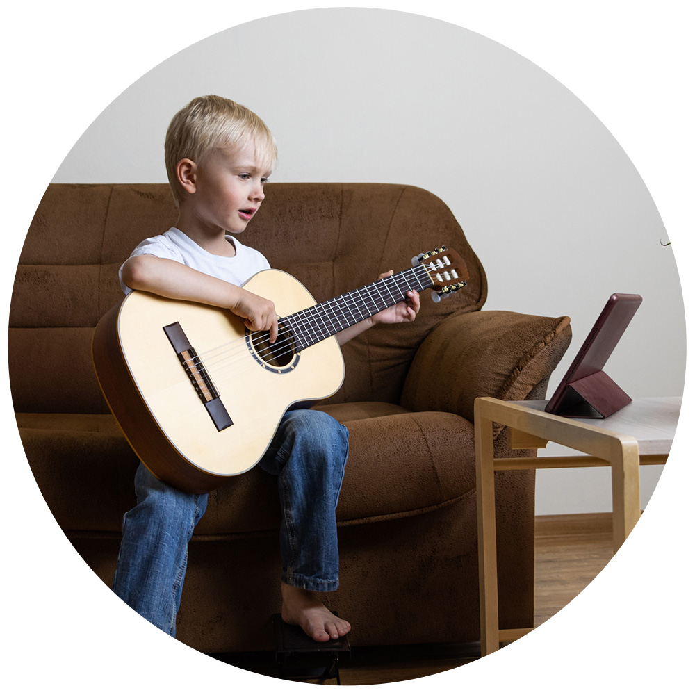 Young boy on guitar with ipad